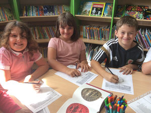 Pupils enjoying creating their own seals